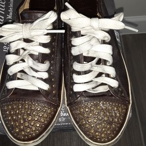 Distressed Studded Frye sneakers.
